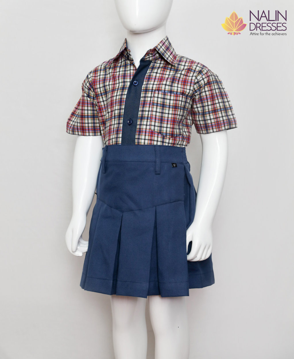 Checkered shirt with blue buttons and navy blue skirt